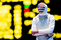 31 JUL 2012 - LONDON, GBR - Miles Chamley-Watson (USA) of the USA waits for the referee's decision during his round of 32 men's individual foil match against Alaaeidin Abouelkassem (EGY) of Egypt at the ExCel Exhibition Centre in London Docklands, London, Great Britain (PHOTO (C) 2012 NIGEL FARROW)