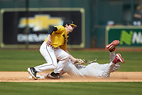 Tyler Hardman (36) of the Oklahoma Sooners is tagged out by Mark Vierling (9) of the Missouri Tigers as he attempts to steal second base in game four of the 2020 Shriners Hospitals for Children College Classic at Minute Maid Park on February 29, 2020 in Houston, Texas. The Tigers defeated the Sooners 8-7. (Brian Westerholt/Four Seam Images)