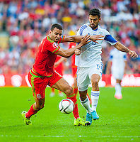 (L-R ) Hal Robson-Kanu of Wales battles with Orel Dgani of Isreal during their UEFA EURO 2016 Group B qualifying round match held at Cardiff City Stadium, Cardiff, Wales, 06 September 2015. EPA/DIMITRIS LEGAKIS