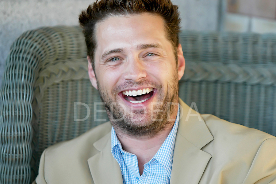 Canadian actor Jason Priestly laughs as he sits in front of the Fairmont Empress Hotel in Victoria, British Columbia, Canada. Photo assignment for the Victoria Times Colonist newspaper.