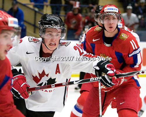Jonathan Toews (Winnipeg, MB - University of North Dakota Fighting Sioux), Ilya Zubov (Khimik Moscow) - Team Canada defeated Team Russia 4-2 to win the gold medal at the 2007 World Junior Championship at Ejendals Arena in Leksand, Sweden on January 5, 2007.