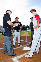 Kannapolis Intimidators manager Tommy Thompson (39) meets at home plate with umpires Brian Peterson (left) and Scott Costello as well as Ramon Oviedo (8) of the Lakewood BlueClaws prior to the South Atlantic League game at CMC-Northeast Stadium on August 14, 2013 in Kannapolis, North Carolina.  The Intimidators defeated the BlueClaws 10-2.  (Brian Westerholt/Four Seam Images)