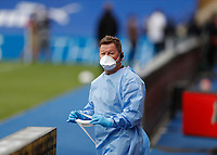 7th July 2020; Selhurst Park, London, England; English Premier League Football, Crystal Palace versus Chelsea; Member of the medical team wearing full PPE from the dugout before kick off