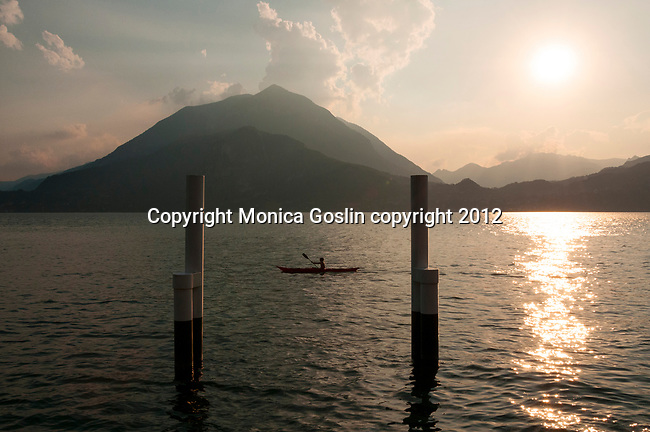 Kayaker on Lake Como, Italy at sunset