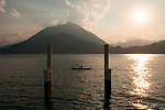 Kayaker on Lake Como, Italy at sunset