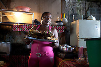 Jan. 04, 2012 - Quibdo, Colombia. A woman serves lunch in the markets. © Nicolas Axelrod / Ruom