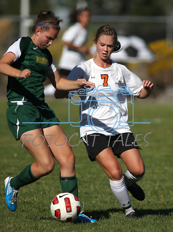 Tia Lyons battles for the ball during Douglas' 4-1 victory over Manogue on Tuesday, Sept. 20, 2011 at Douglas High School in Gardnerville, Nev..Photo by Cathleen Allison