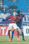 Guangzhou Midfielder Paulinho Maciel (L) fights for the ball with Suwon Midfielder Kim Jongwoo (R) during the AFC Champions League 2017 Group G match Between Suwon Samsung Bluewings (KOR) vs Guangzhou Evergrande FC (CHN) at the Suwon World Cup Stadium on 01 March 2017 in Suwon, South Korea. Photo by Victor Fraile / Power Sport Images