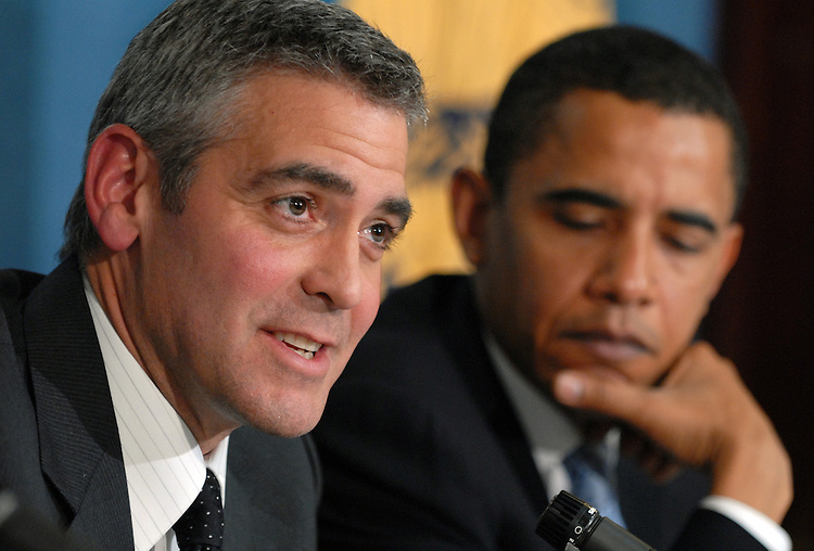 """Actor George Clooney, left, appeared at the National Press Club for """"SAVE DARFUR: Rally to Stop Genocide.""""  He discussed he and his father's recent visit to the region.  Sens. Sam Brownback, R-Kan., and Barack Obama, D-Ill., right, also attended."""