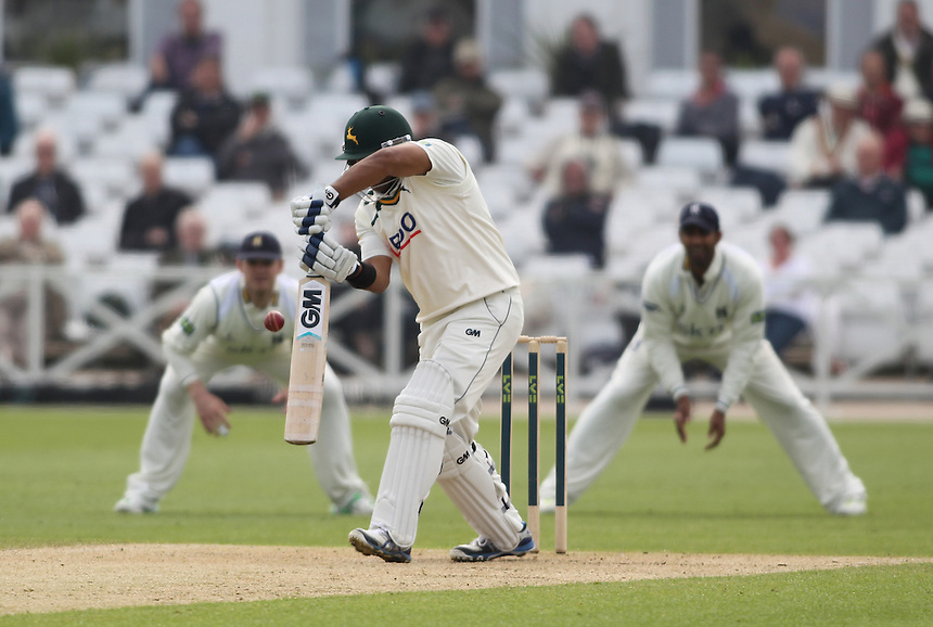 Nottinghamshire's Samit Patel nicks a ball to Warwickshire's William Porterfield off the bowling of Keith Barker<br />