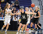 SIOUX FALLS, SD: MARCH 12:  Paige Redmond #00 of Central Missouri knocks the ball away from Logan O'Farrell #30 of Augustana during the 2018 NCAA Division II Women's Basketball Central Region Championship Monday at the Elmen Center in Sioux Falls, S.D. (Photo by DIck Carlson/Inertia)