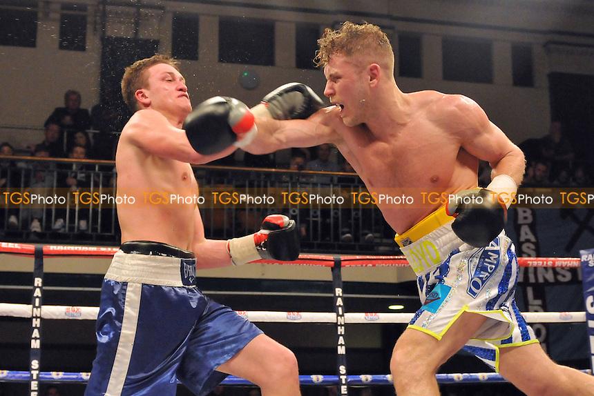 Lloyd Ellett (white/blue shorts) defeats Raimonds Sniedze - Boxing at York Hall, Bethnal Green, London - 27/03/15 - MANDATORY CREDIT: TGSPHOTO - Self billing applies where appropriate - contact@tgsphoto.co.uk - NO UNPAID USE