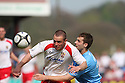 Chris Beardsley of Stevenage Borough and Luke Graham of York City battle for possession during the Blue Square Premier match between Stevenage Borough and York City at the Lamex Stadium, Broadhall Way, Stevenage on Saturday 24th April, 2010..© Kevin Coleman 2010 ..