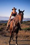 Femaler Horseback rider on horse in the hills above the ocean near Morro Bay, Montana de Oro State Park, California