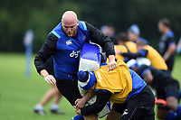 Matt Garvey of Bath Rugby is tackled. Bath Rugby pre-season training session on August 9, 2017 at Farleigh House in Bath, England. Photo by: Patrick Khachfe / Onside Images