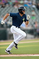 First baseman Brian Sharp (7) of the Columbia Fireflies runs out a batted ball in a game against the Lexington Legends on Friday, May 3, 2019, at Segra Park in Columbia, South Carolina. Lexington won, 5-2. (Tom Priddy/Four Seam Images)