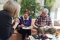 Former Massachusetts governor Michael Dukakis (right) and his wife Kitty Dukakis (center) speak with Kate MacDonald (left), of Cambridge, Mass., during a support group for people who have had electroconvulsive therapy in their home in Brookline, Massachusetts, USA, on Sun., Dec. 4, 2016. MacDonald has undergone electroconvulsive therapy and attended the meeting with her husband Merritt Harrison (not pictured). Kitty Dukakis used ECT to treat depression and substance abuse issues. She continues to have ECT treatments about once every seven or eight weeks.
