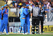 8th February 2019, Eden Park, Auckland, New Zealand;  Daryl Mitchell is given out as Kane Williamson and India's MS Dhoni and Rohit Sharma look on.<br />