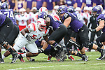 Southern Methodist Mustangs defensive tackle Darrian Wright (54) tackles TCU Horned Frogs running back B.J. Catalon (23) during the game between the SMU Mustangs and the TCU Horned Frogs at the Amon G. Carter Stadium in Fort Worth, Texas. TCU defeats SMU 48 to 17.