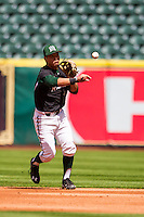 Hawaii Rainbow Warriors second baseman JJ Kitaoka (14) makes a throw to first base during Houston College Classic against the Baylor Bears on March 6, 2015 at Minute Maid Park in Houston, Texas. Hawaii defeated Baylor 2-1. (Andrew Woolley/Four Seam Images)
