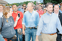 Democratic presidential candidate Tom Steyer walks along the Grand Concourse at the Iowa State Fair in Des, Moines, Iowa, on Sun., Aug. 11, 2019.