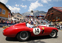 20.07.2013.  Ennstal Classic 2013 Grobming Austria  Picture shows Sir Stirling Moss GBR in a Ferrari at Monza