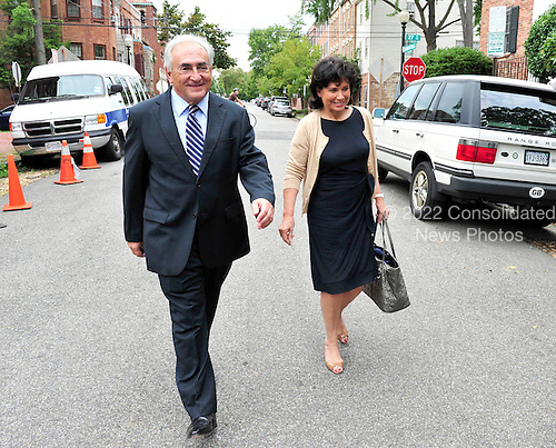 Dominique Strauss-Kahn, the former head of the International Monetary Fund (IMF), and his wife, Anne Sinclair, return to their Georgetown home after visiting IMF headquarters in Washington, D.C. on Monday, August 29, 2011..Credit: Ron Sachs / CNP.(RESTRICTION: NO New York or New Jersey Newspapers or newspapers within a 75 mile radius of New York City)