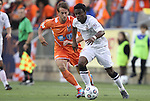 28 April 2012: San Antonio's Walter Ramirez (HON) (in white) pushes past Carolina's Mike Palacio (in orange). The San Antonio Scorpions defeated the Carolina RailHawks 1-0 at WakeMed Soccer Stadium in Cary, NC in a 2012 North American Soccer League (NASL) regular season game. It was the first win for the expansion team from San Antonio.