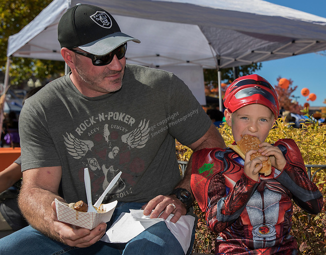 Chris Cross and 6-year old Bobby during Pumpkin Palooza in Sparks, Nevada on Sunday, Oct. 22, 2017.