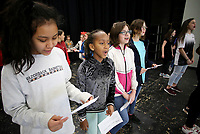 NWA Democrat-Gazette/DAVID GOTTSCHALK Mattie Smith (from left) Susan Kuria, Mari Wist and Olivia Harrell, all sixth grade students at Holt Middle School, practice singing Seventy-Six Trombones Monday, February 12, 2018, during practice with other students before auditions at the school in Fayetteville. The students are auditioning for The Music Man Kids musical. This year marks the 18th year for a musical at the school. Auditions will be held today also.
