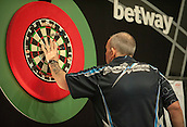 09.04.2015. Sheffield, England. Betway Premier League Darts. Matchday 10.  Phil Taylor [ENG] retrieves his darts during his game with Raymond van Barneveld [NED]
