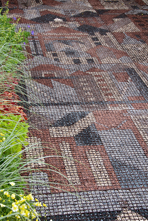 Unusual patterned patio made of stones mosaic