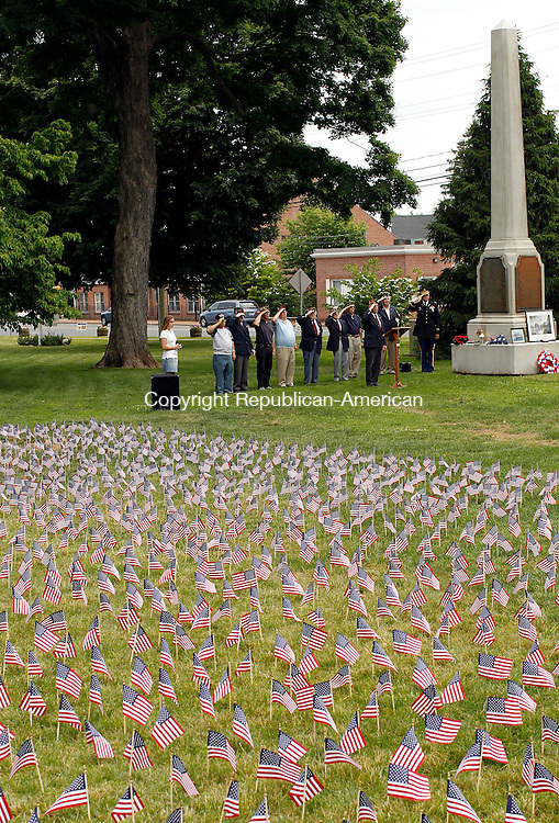 "Cheshire, CT-29, May 2010-052910CM03 ""Field of Flags"" The event was held honoring fallen soldiers in the Iraq and Afghanistan.  Some 5,487 flags were seen on the green in front of the First Congregational Church in Cheshire.  This service honored the fallen from the Korean War. --Christopher Massa Republican-American"