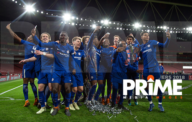 Chelsea players celebrate winning the trophy during the FA Youth Cup FINAL 2nd leg match between Arsenal and Chelsea at the Emirates Stadium, London, England on 30 April 2018. Photo by Andy Rowland.