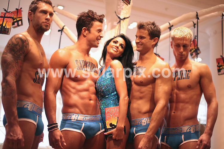 **ALL ROUND PICTURES FROM SOLARPIX.COM**.**NO UK NEWSPAPER PUBLICATION**.**UK MAGAZINE & SUPPLEMENT PUBLICATION ONLY** AND NO PUBLICATION IN AUSTRALIA, FRANCE, GERMANY, ITALY AND SCANDINAVIA** .Katie Price turned back into Jordan today during her launch for her latest novel called Sapphire at Selfridges in central London. .She was helped by on off boyfriend Anthony Lowther and his Dynamite Hosts from Ibiza..JOB REF:   9591   SFE       DATE:  23.07.09.**MUST CREDIT SOLARPIX.COM OR DOUBLE FEE WILL BE CHARGED**.**ONLINE USAGE FEE GBP 50.00 PER PICTURE - NOTIFICATION OF USAGE TO PHOTO @ SOLARPIX.COM**.**CALL SOLARPIX : +34 952 811 768 or LOW RATE FROM UK 0844 617 7637**