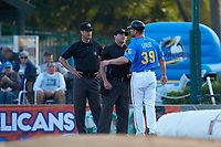 Myrtle Beach Pelicans manager Steve Lerud (39) argues with umpires Mark Bass (left) and Jake Bruner during the game against the Winston-Salem Dash at TicketReturn.com Field on May 16, 2019 in Myrtle Beach, South Carolina. The Dash defeated the Pelicans 6-0. (Brian Westerholt/Four Seam Images)