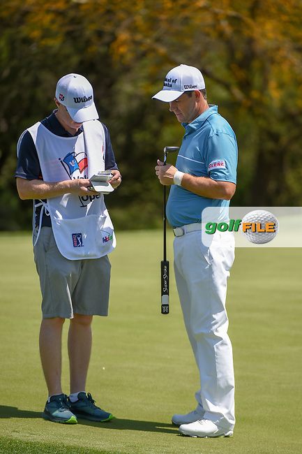 Padraig Harrington (IRL) talks to his caddie after sinking his putt on 17 during day 1 of the Valero Texas Open, at the TPC San Antonio Oaks Course, San Antonio, Texas, USA. 4/4/2019.<br /> Picture: Golffile | Ken Murray<br /> <br /> <br /> All photo usage must carry mandatory copyright credit (© Golffile | Ken Murray)
