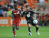 DC United midfielder forward Dwayne De Rosario (7) shields the ball against Toronto FC defender Doneil Henry (4) DC United tied Toronto FC 3-3 at RFK Stadium, Saturday August 6 , 2011.