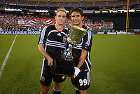 DC United forward Jaime Moreno (99) and defender Ryan Namoff (26) hold the Atlantic Cup Trophy after the victory. DC United defeated the New York Red Bulls 3-1, at RFK Stadium in Washington DC, Thursday August  22, 2007.