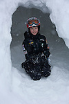 boy at entrance of snow cave, fun, outdoor winter activities at Copper Mountain Ski Resort, Copper Mountain, Colorado, USA, (MR); model released, #94, Jack A