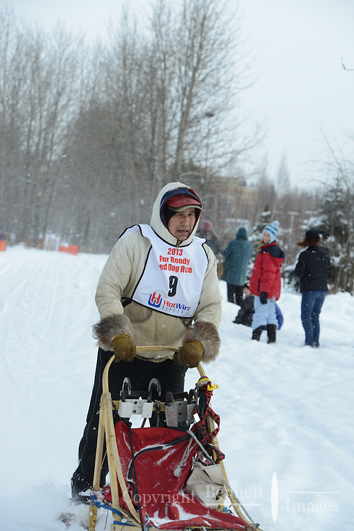 Marvin Kokrine passes by University Lake during the first day of the World Championship Sled Dog Races, a highlight of the 2013 Anchorage, Alaska, Fur Rendezvous.