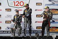 2017 IMSA Continental Tire SportsCar Challenge<br /> Visit Sebring 120<br /> Sebring International Raceway, Sebring, FL USA<br /> Friday 17 March 2017<br /> 60, Ford, Ford Mustang, GS, Jade Buford, Scott Maxwell, podium, champgne<br /> World Copyright: MIchael L. Levitt<br /> LAT Images<br /> ref: Digital Image levitt_seb_0317-15443
