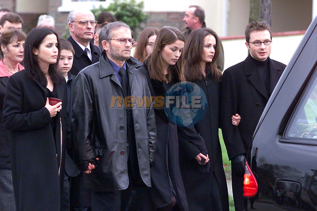 The Corr Family Walking behine there mothers coffin on the way to church.Pic Newswfile.By Line Please..Camera:   DCS620C.Serial #: K620C-01943.Width:    1728.Height:   1152.Date:  27/11/99.Time:   13:56:27.DCS6XX Image.FW Ver:   1.9.6.TIFF Image.Look:   Product.Counter:    [627].Shutter:  1/250.Aperture:  f4.0.ISO Speed:  640.Max Aperture:  f2.8.Min Aperture:  f32.Focal Length:  150.Exposure Mode:  Manual (M).Meter Mode:  Color Matrix.Drive Mode:  Continuous High (CH).Focus Mode:  Continuous (AF-C).Focus Point:  Center.Flash Mode:  Normal Sync.Compensation:  +0.0.Flash Compensation:  +0.0.Self Timer Time:  10s.White balance: Auto (Daylight).Time: 13:56:27.962.