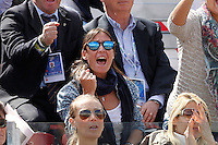 Italian tennis player Flavia Pennetta   applauds her boyfriend Italy's Fabio Fognini during his Davis Cup quarter-final tennis match against Britain's Andy Murray in Naples April 6, 2014.