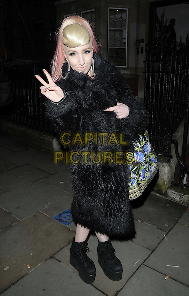 Alexis Knox.attended the Alexis Publicity new communications agency launch party, Simon Oldfield Gallery, London, England..February 6th, 2013.full length black fur coat pink hair dyed streaks blue green floral print bag purse hand v peace sign platform sneakers trainers .CAP/CAN.©Can Nguyen/Capital Pictures.