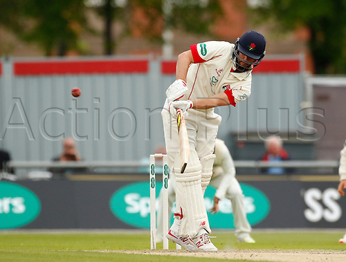 23.05.2016. Old Trafford, Manchester, England. Supersavers County Championship. Lancashire versus Surrey. Lancashire all-rounder Tom Smith plays a shot off his legs as he reaches 50 with the final ball of the morning session.