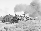 D&amp;RGW pipe train moving thru Allison, Colorado.  Lead engine is K-37 #491.  Second engine is a K-36.  View is from the west end of the depot, train is westbound.<br /> D&amp;RGW  Allison, CO  Taken by Richardson, Robert W. - 3/2/1958