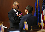 Nevada Senate Minority Leader Aaron Ford, D-Las Vegas, left, and Majority Leader Michael Roberson, R-Henderson, talk during a special session at the Legislative Building in Carson City, Nev. on Thursday, Oct. 13, 2016. Cathleen Allison/Las Vegas Review-Journal