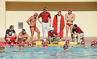 STANFORD, CA - October 9, 2010: Head Coach John Vargas talks to the team during a water polo game against USC in Stanford, California. Stanford beat USC 5-3.