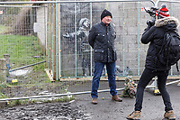 Pictured: Ian Lewis and a camera crew from BBC's The One Show in Port Talbot. Friday 01 February 2019<br /> Re: Gallery owner and art collector John Brandler meets with garage owner Ian Lewis, where Banksy created his latest graffiti in Port Talbot, Wales, UK.